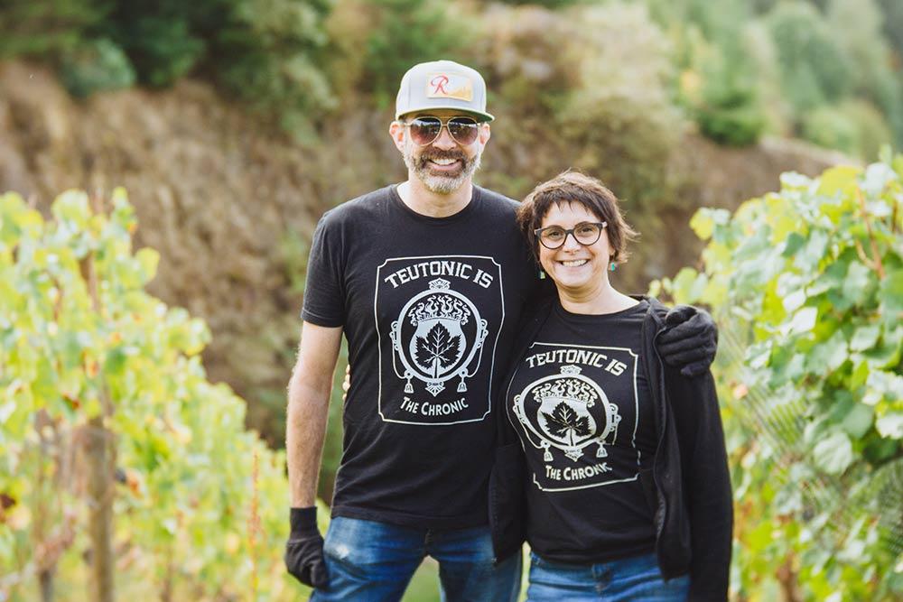 Barnaby and Olga in the vineyard.